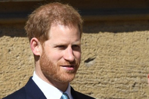 Harry arrives at Easter Sunday church service without heavily pregnant Meghan fuelling speculation royal baby is imminent