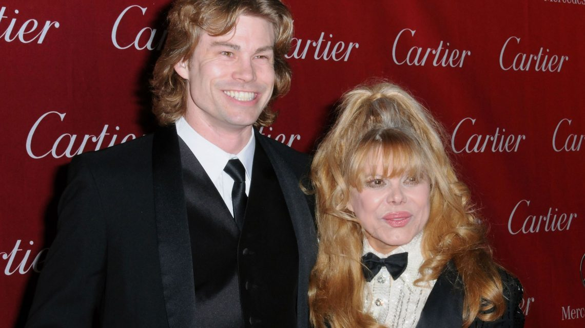 Charo and son Shel plant a tree in honor of late husband