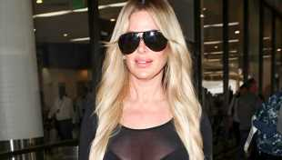 Kim Zolciak-Biermann Slays In Strapless Leopard Print One Piece While Sipping On Martini — See Pic