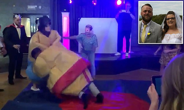 Bride and groom have first dance in Sumo suits and wrestle each other