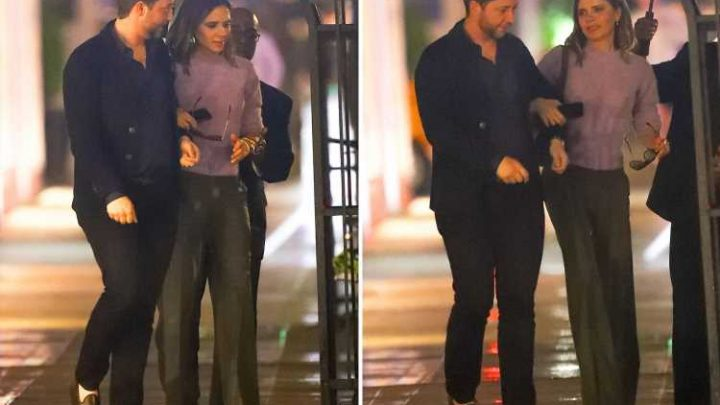 Victoria Beckham smiles as she strolls arm in arm with man on night out in New York