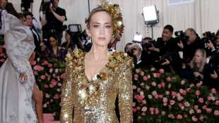 Emily Blunt Stuns In Glittery Gold Dress & Headpiece At 2019 Met Gala