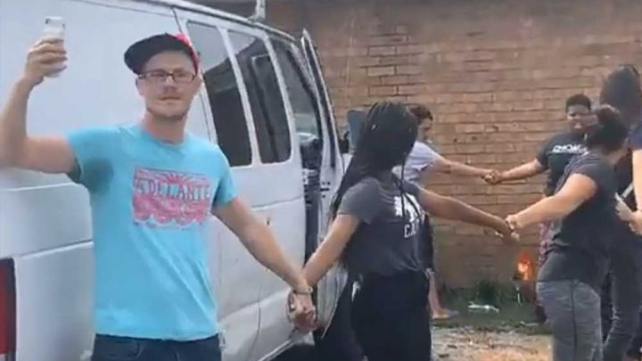 Activists form human chain to stop ICE from taking man, young son into custody