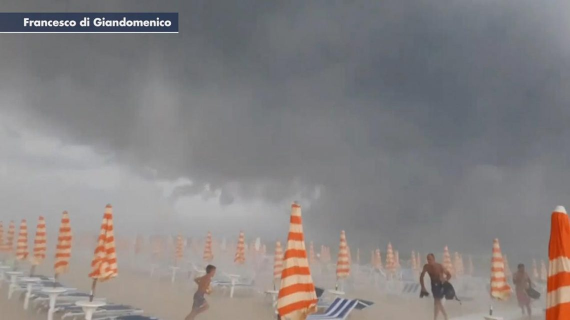 Storm hits beach in Italy, sends sunbathers fleeing debris as freak weather plagues the country