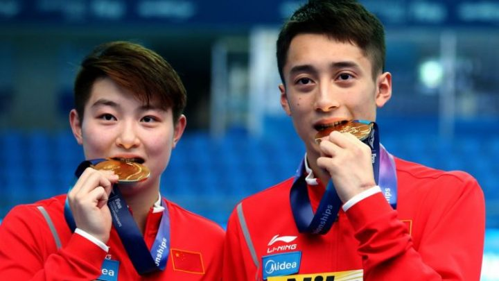 Diving: Chinese divers plunder triple gold at world championships