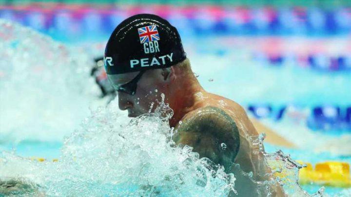 Adam Peaty retains world 100m breaststroke crown in South Korea