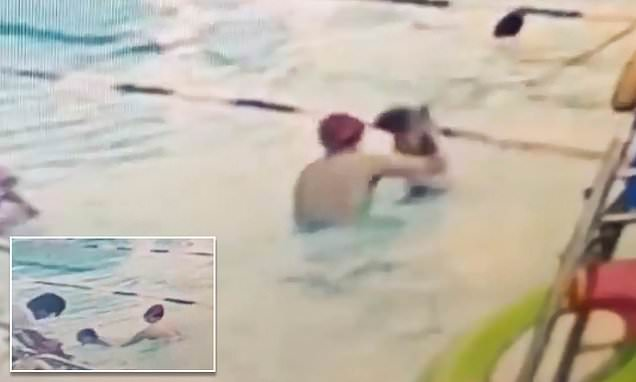Swimming coach repeatedly slams a boy into the pool as punishment