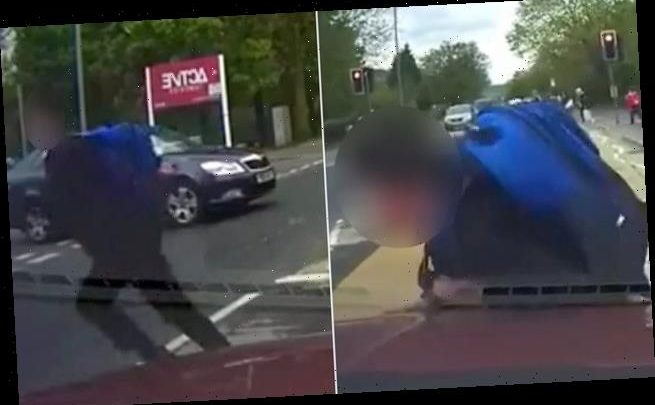 Shocking moment schoolboy deliberately runs into path of oncoming taxi