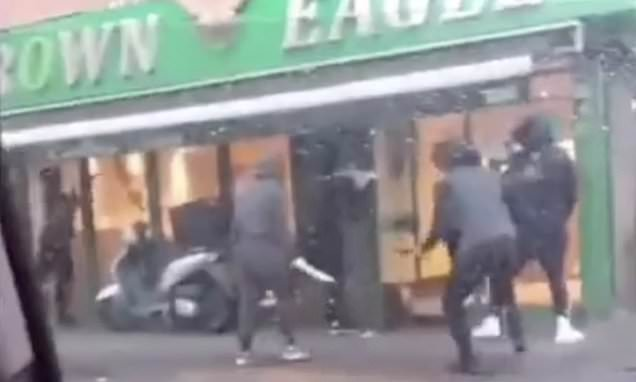 Shocking moment gangs of hooded thugs armed with knives brawl