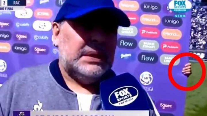 Watch hilarious Maradona interview as man holding advertising board follows him around because Argentina legend doesn't like standing still – The Sun