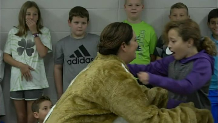 Missouri girl surprised at elementary school when military mom comes home