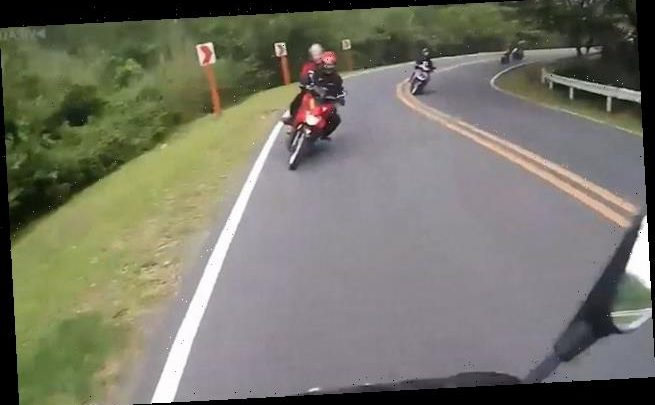 Moment motorcyclist crashes head-on into oncoming biker on blind bend