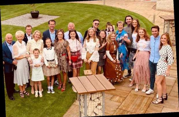 Family of 23 sit down for traditional Christmas dinner complete with crackers and party hats 11 WEEKS early – The Sun