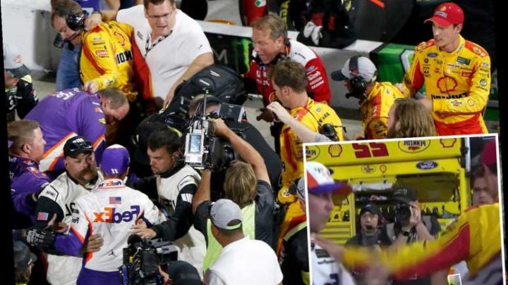 Watch shocking moment Nascar drivers fight on the floor as mass brawl breaks out at side of race track – The Sun