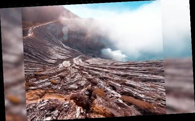 Drone films its descent into the crater of a 9,000ft volcano