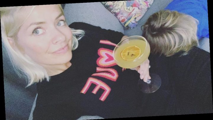 Holly Willoughby enjoys a cocktail on the sofa with son Chester after flat tyre drama – The Sun