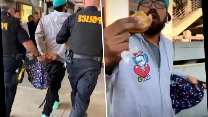 Shocking moment white cops arrest black man for eating a SANDWICH after singling him out' on train platform – The Sun