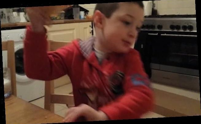 Excited child falls off his chair when he hears ice-cream van's music