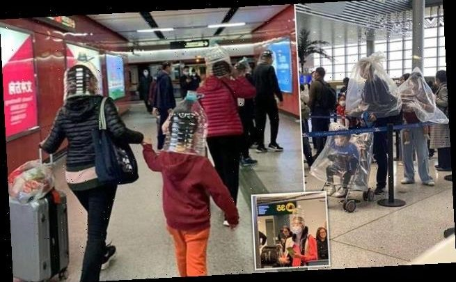 Nervous Chinese travellers are pictured wearing face masks