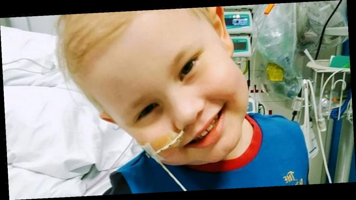 Proud parents celebrate as 'superhero' boy, 5, wins battle with rare cancer