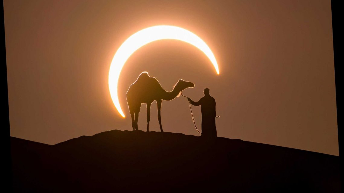 Brilliant perfectly-timed snap captures moment farmer and camel stand in front of a solar eclipse – The Sun