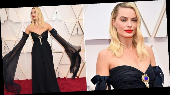 The Statement Sleeves on Margot Robbie's Oscars Gown Practically Reach the Red Carpet