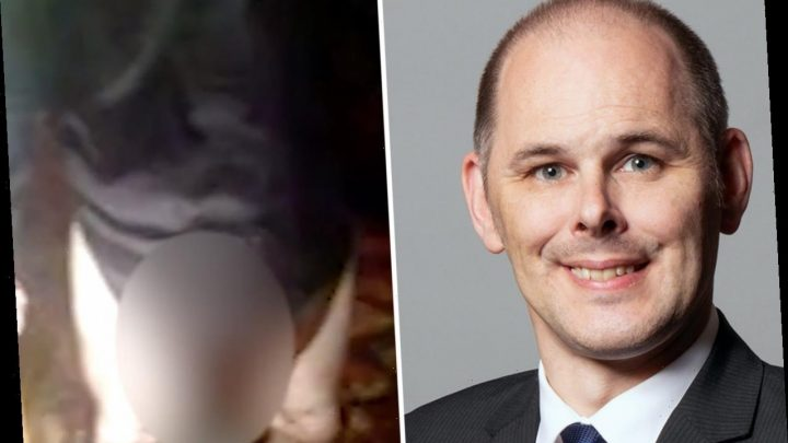 British MP apologizes after being filmed exposing himself to a woman in a pub