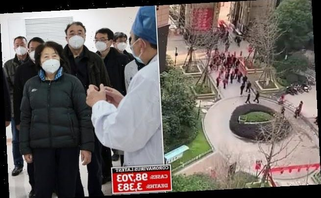 Wuhan residents shout 'fake' as Premier inspects a residential block
