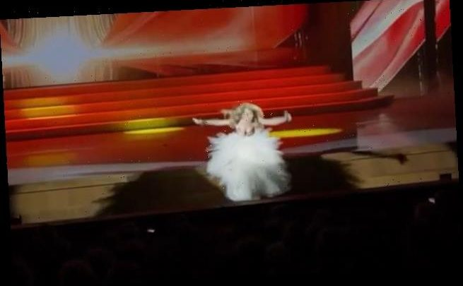 Russian singer finishes her song despite falling 10ft off a stage