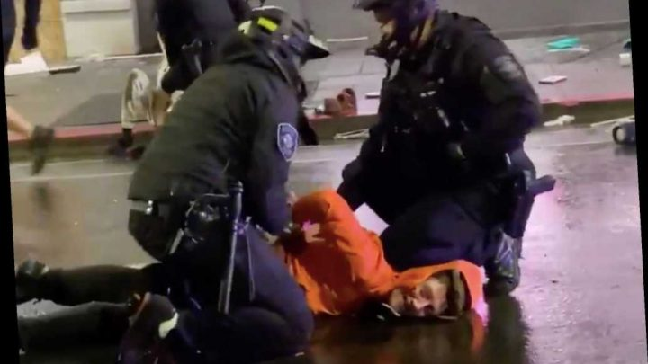Seattle cop removes colleague's knee from protester's neck, video shows
