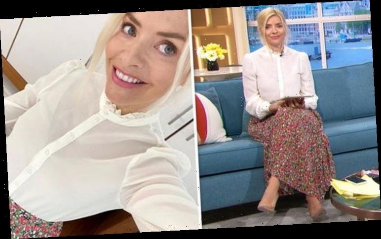 Holly Willoughby looks elegant in silk blouse and floral skirt – and it's still in stock
