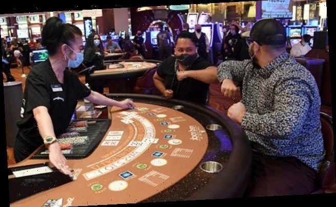 Huge crowds line up as casinos reopen in Las Vegas for the first time