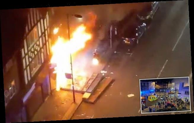 Woman pulled from burning flat as explosion rips through dry cleaners