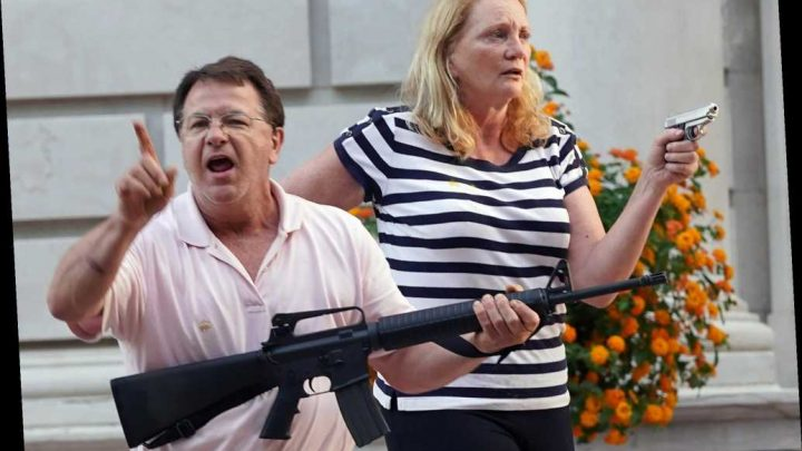 St. Louis couple hit with criminal charges for waving guns at BLM protesters
