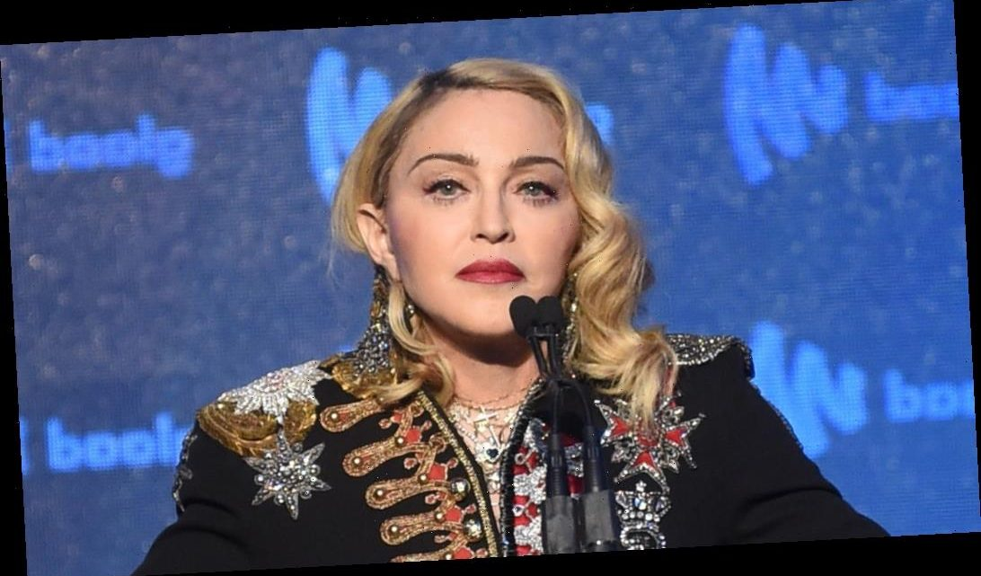 Madonna Goes Topless & Poses with Her Crutch – See Photo!