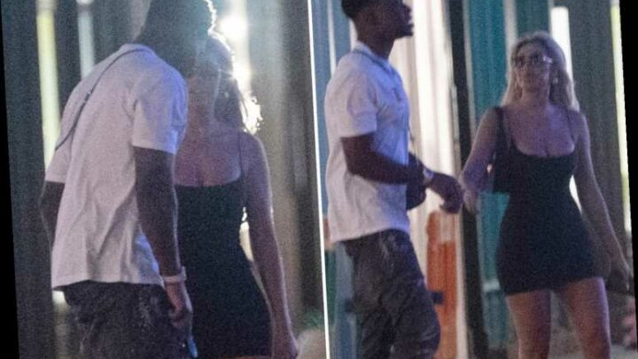 Chloe Ferry holds hands with mystery man as she steps out in skintight black dress in London