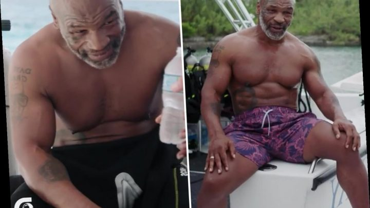 Mike Tyson looks even more ripped in latest video as he dives with SHARKS ahead of comeback aged 54