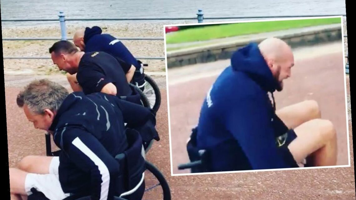 Tyson Fury joins gruelling seven-mile wheelchair race along Morecambe Bay 36 hours after sparring for fans with dad John
