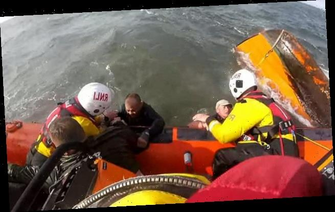 RNLI lifesavers rescue three fishermen as they cling to their boat