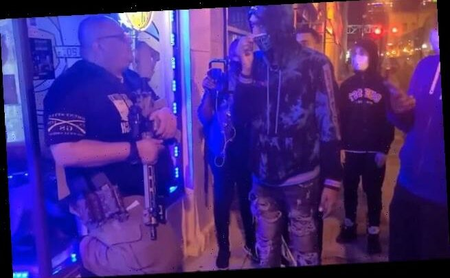 BLM protesters confront gun-toting storeowner in Louisville