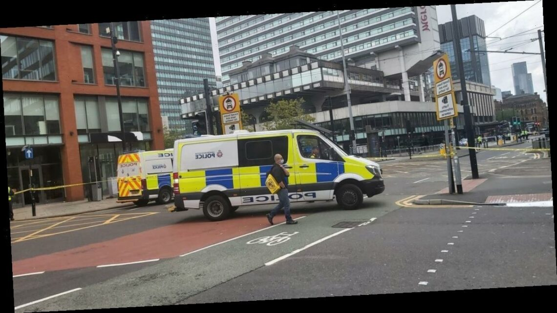 Cops swoop after reports of a suspicious package on a bus in Manchester