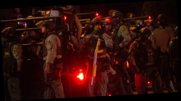 Manhunt for gunman who shot 2 California deputies in their patrol car