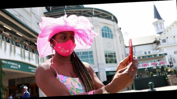 Photos of the historic 2020 Kentucky Derby reveal festive face masks and empty bleachers