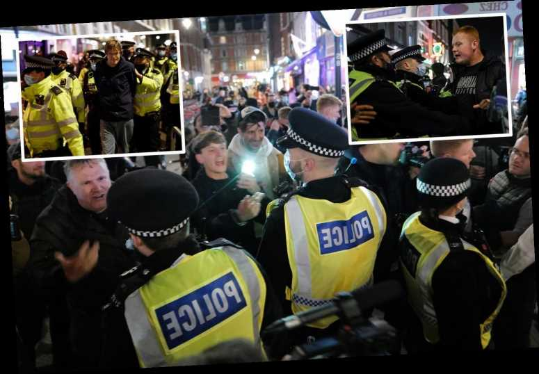 Cops clash with crowds of drinkers in London before capital is plunged into Tier 2 coronavirus lockdown
