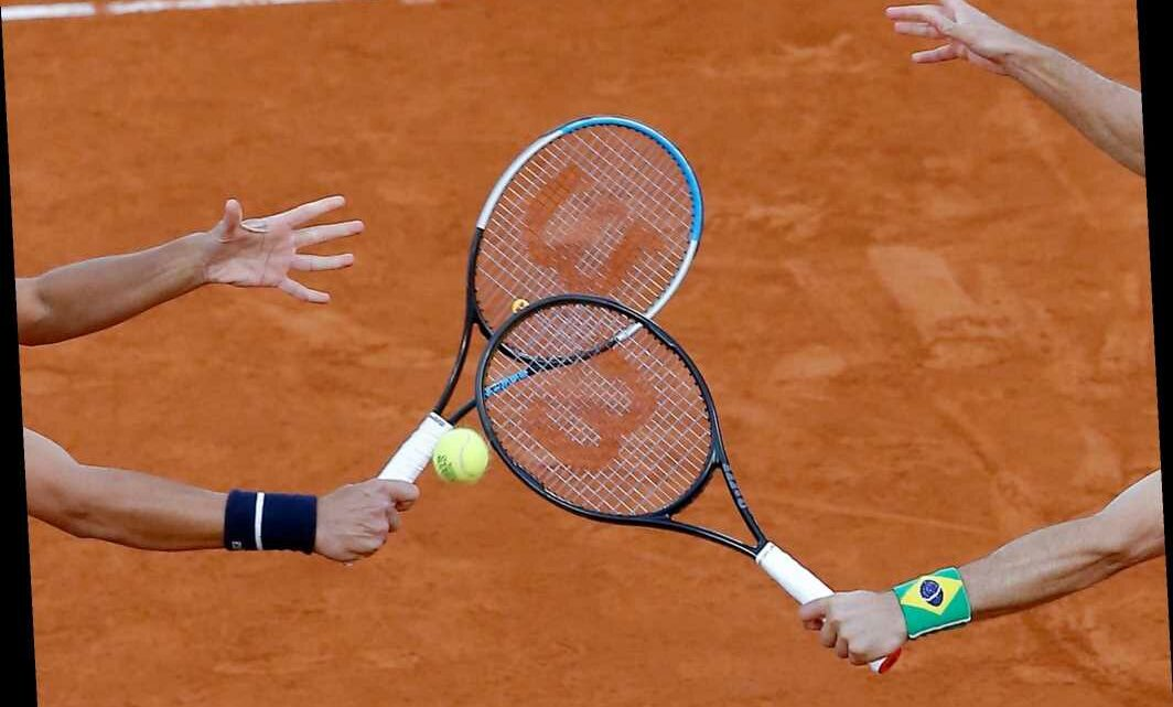 The Latest: COVID hits French Open revenues; 2021 still on
