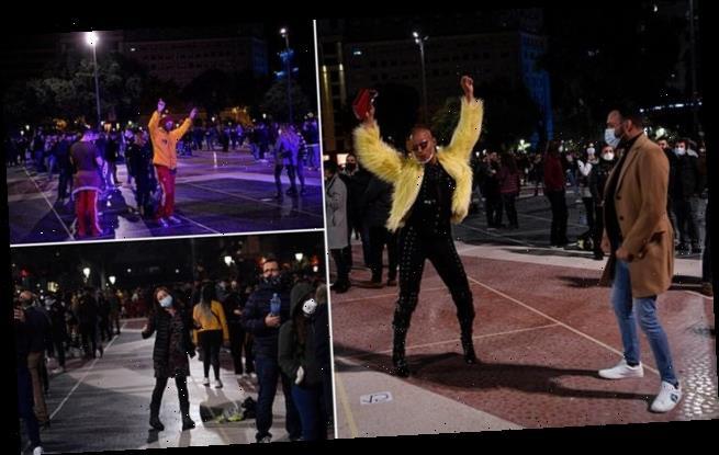 Hundreds of revellers dance on the streets of Barcelona