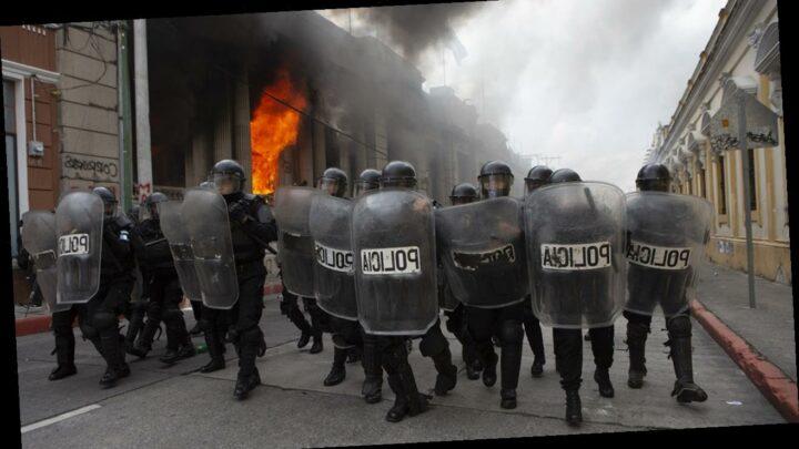 Protesters in Guatemala break into Congress building, set fire