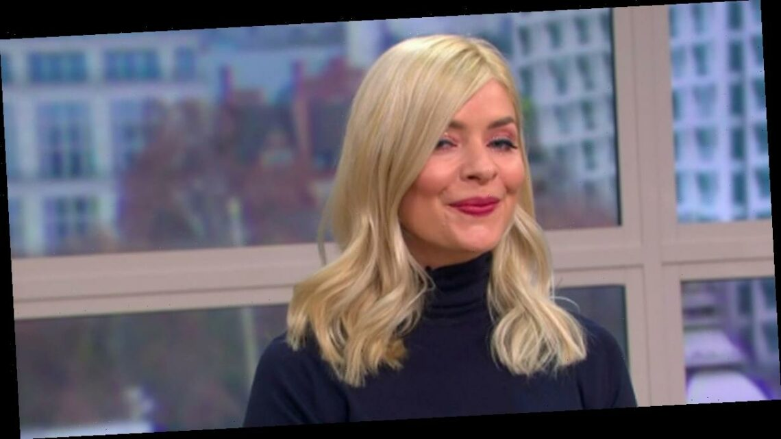 Holly Willoughby dances in slinky skirt and skintight jumper on This Morning
