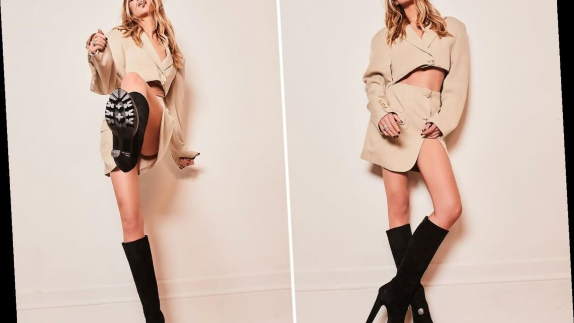 Abbey Clancy shows off her endless legs in a pair of statement black boots