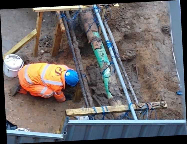 Stunned workers unearth SIX skeletons in city centre as archaeologists are called in to investigate riddle